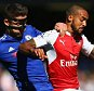 LONDON, ENGLAND - SEPTEMBER 19: Theo Walcott of Arsenal and Gary Cahill of Chelsea compete for the ball during the Barclays Premier League match between Chelsea and Arsenal at Stamford Bridge on September 19, 2015 in London, United Kingdom.  (Photo by Ian Walton/Getty Images)