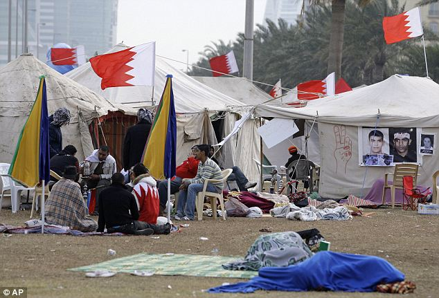 Ongoing protest: Bahraini anti-government demonstrators sleep outside their tents after nearly a week of unrest