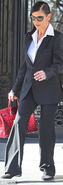 She means business: Catherine looked like she might have borrowed one of her husband's shits as she went shopping in New York earlier in the day