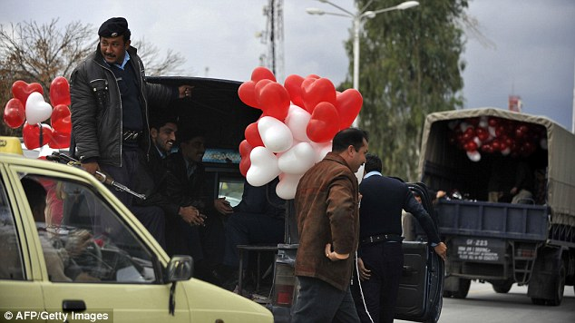 Pakistani police detain street vendors selling balloons on Valentine's Day in Islamabad on February 14, 2011