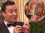 20 September 2015 - Los Angeles - USA  **** STRICTLY NOT AVAILABLE FOR USA ***  Jimm Fallon shows off mangled purple-coloured finger as he ditches the bandage on Emmy red carpet. The Tonight Show host almost amputated his ring finger on his left hand back in June following a freak accident at his home. Since then he's been constantly wearing bandages around the finger as it healed. But as he stopped to chat to E!'s Ryan Seacrest on the Emmy carpet, the injury was clear to see as Fallon showed off his finger without any bandage. As he showed off cute pictures of his two daughers Winnie and Frances, viewers saw the finger still looking swollen and purple with what looked like stitches still in it.   XPOSURE PHOTOS DOES NOT CLAIM ANY COPYRIGHT OR LICENSE IN THE ATTACHED MATERIAL. ANY DOWNLOADING FEES CHARGED BY XPOSURE ARE FOR XPOSURE'S SERVICES ONLY, AND DO NOT, NOR ARE THEY INTENDED TO, CONVEY TO THE USER ANY COPYRIGHT OR LICENSE IN THE MATERIAL. BY PUBLISHING THIS MATERIAL , THE USER