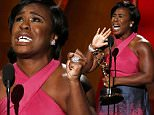 """Uzo Aduba accepts the award for Outstanding Supporting Actress In A Drama Series for her role in Netflix's """"Orange is the New Black"""" at the 67th Primetime Emmy Awards in Los Angeles, California September 20, 2015.  REUTERS/Lucy Nicholson"""