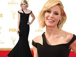 IMAGE DISTRIBUTED FOR THE TELEVISION ACADEMY - Julie Bowen arrives at the 67th Primetime Emmy Awards on Sunday, Sept. 20, 2015, at the Microsoft Theater in Los Angeles. (Photo by Danny Moloshok/Invision for the Television Academy/AP Images)