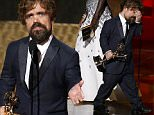"Peter Dinklage accepts the award for Outstanding Supporting Actor In A Drama Series for his role in HBO's ""Game of Thrones"" from presenter Viola Davis (rear) at the 67th Primetime Emmy Awards in Los Angeles, California September 20, 2015.  REUTERS/Lucy Nicholson"