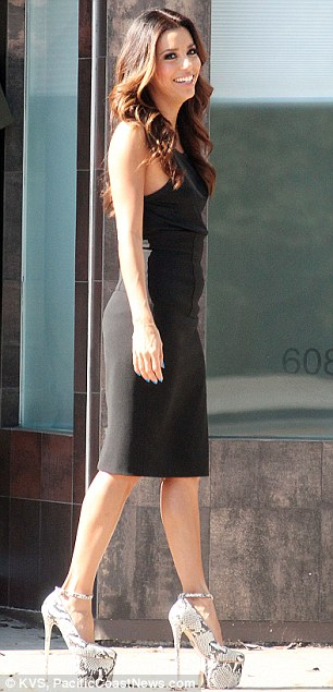 Beauty in black: The 37-year-old looked sensational in a black shift dress complete with zipper detailing at the back