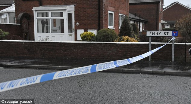 Investigation: Police cordoned off the street after arresting the victim's mother and stepfather
