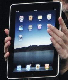 Apple Chief Executive Officer Steve Jobs holds the much lauded iPod, now being given away to technology graduates