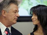 U.S. actor and activist Alec Baldwin speaks with his wife Hilaria as he appears at a news conference at United Nations headquarters in New York, September 21, 2015. The event was held by the United Nations Development Programme to announce the winners of the 2015 Equator Prize, an award that recognizes outstanding local solutions for people, nature and resilient communities.  REUTERS/Mike Segar