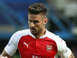 Arsenal's Olivier Giroud, left , takes the ball away from Chelsea's Ramires during the English Premier League soccer match between Chelsea and Arsenal at Stamford Bridge stadium in London, Saturday, Sept. 19, 2015. (AP Photo/Alastair Grant)