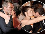 """David Benioff kisses his wife, actress Amanda Peet, as he takes the stage to accept the award for Outstanding Writing For A Drama Series for HBO's """"Game of Thrones"""" at the 67th Primetime Emmy Awards in Los Angeles, California September 20, 2015.  REUTERS/Lucy Nicholson"""