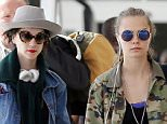 Picture Shows: Cara Delevingne, St. Vincent  September 20, 2015    Cara Delevingne and her girlfriend St. Vincent arrive on a flight at Heathrow Airport in London, UK. The couple were seen hopping on motorbikes to make their way into central London.  Not before taking a selfie on their phones !!    Exclusive All Round  WORLDWIDE RIGHTS    Pictures by : FameFlynet UK � 2015  Tel : +44 (0)20 3551 5049  Email : info@fameflynet.uk.com