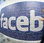 This picture taken with a fisheye lens shows a man walks past a big logo created from pictures of Facebook users worldwide in the company's Data Center, its first outside the US in Lulea, in Swedish Lapland, Sweden.  The company began construction on the facility in October 2011 and went live on June 12, 2013 and are 100% run on hydro power.   AFP PHOTO/JONATHAN NACKSTRAND        (Photo credit should read JONATHAN NACKSTRAND/AFP/Getty Images)