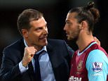 LONDON, ENGLAND - SEPTEMBER 14: Slaven Bilic manager of West Ham United talks to Andy Carroll of West Ham United before he comes on as substitute during the Barclays Premier League match between West Ham United and Newcastle United on September 14, 2015 in London, United Kingdom.  (Photo by Catherine Ivill - AMA/Getty Images)
