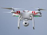 """File photo dated 09/05/14 of a quadcopter type drone with a camera, as the House of Lords' EU Committee has called for a tracking system for all drones and their users. PRESS ASSOCIATION Photo. Issue date: Thursday March 5, 2015. In its latest report, the Committee described drones, officially known as Remotely Piloted Aircraft Systems (RPAS), as an """"exciting new technology"""". See PA story LORDS Drones. Photo credit should read: Niall Carson/PA Wire"""