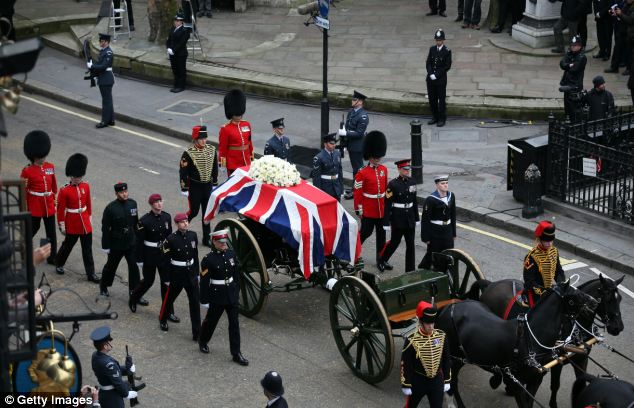 Pomp and ceremony: Baroness Thatcher's coffin is taken to St Paul's Cathedral, with L/Cpl Steel walking alongside in his maroon beret