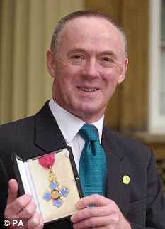 Insensitive: Sir Richard Leese receiving his MBE in 1991