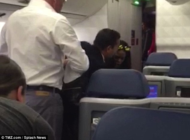 On film: Her blow up was caught on video by another passenger - the singer grappled with the flight attendant for her bag