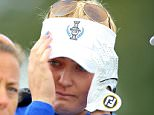 SANKT LEON-ROT, GERMANY - SEPTEMBER 20: Charley Hull of the European Team in tears on the 18th green where she is being comforted by Fanny Sunesson (l) and European Team vice captain Maria McBride (r) after Hull's match with Suzann Pettersen had ended acrimoniously after the European pair had won the 17th hole when the American rookie Alison Lee had inadavertantly picked up her ball before her putt had been conceded during the completion of the Saturday afternoon fourball matches in the 2015 Solheim Cup at St Leon-Rot Golf Club on September 20, 2015 in Sankt Leon-Rot, Germany.  (Photo by Thomas Niedermueller/Getty Images)