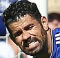 Diego Costa of Chelsea pushes away Laurent Koscielny of Arsenal with his hand in his face near his eyes shortly before Gabriel of Arsenal was sent off. Chelsea v Arsenal, FA Barclays Premier League, Stamford Bridge, London, 19/09/2015 © Matthew Impey/Wiredphotos.co.uk. tel: 07789 130 347 email: matt@wiredphotos.co.uk