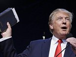 Republican presidential candidate, businessman Donald Trump holds a Bible as he speaks during the Iowa Faith & Freedom Coalition's annual fall dinner, Saturday, Sept. 19, 2015, in Des Moines, Iowa. (AP Photo/Charlie Neibergall)