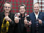 """The Bay City Rollers today announced their reunion at Glasgow Central Hotel. 22 September 2015. l-r Guitarist Stuart John ?Woody� Wood, singer Les McKeon and bassist Alan Longmuir. The Bay City Rollers were a Scottish pop band whose popularity was highest in the mid 1970s. The British Hit Singles & Albums noted that they were """"tartan teen sensations from Edinburgh"""", and were """"the first of many acts heralded as the 'Biggest Group since The Beatles' and one of the most screamed-at teeny-bopper acts of the 1970s"""". For a relatively brief but fervent period (nicknamed """"Rollermania""""), they were worldwide teen idols. The group's line-up featured numerous changes over the years, but the classic line-up during its heyday included guitarists Eric Faulkner and Stuart John Wood, singer Les McKeown, bassist Alan Longmuir, and drummer Derek Longmuir. � Russell Gray Sneddon / StockPix.eu"""