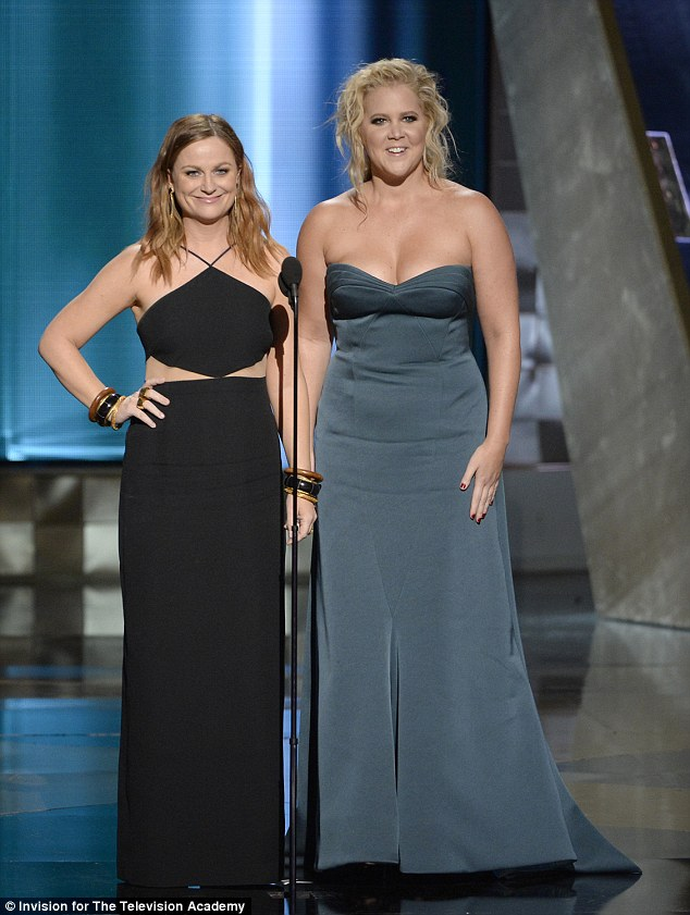 Funny ladies: Amy was more her usual playful self when she took to the stage alongside fellow Amy - Poehler - earlier in the evening