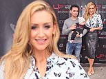 Catherine Tyldesley, her partner Tom Pitfield and their baby Alfie, at the opening of the Ultimate Performance Gym in Manchester, UK.  Pictured: Catherine Tyldesley, Tom Pitfield and baby alfie Ref: SPL1132003  200915   Picture by: DFL / Splash News  Splash News and Pictures Los Angeles: 310-821-2666 New York: 212-619-2666 London: 870-934-2666 photodesk@splashnews.com