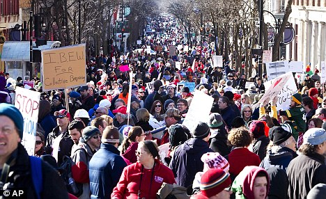 Out in force: More than 50,000 people gathered in Madison on Saturday to protest against the bill, which is trying to address a $137million current budget shortfall