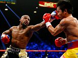 Floyd Mayweather Jr. throws a left at Manny Pacquiao during their welterweight unification championship bout on May 2, 2015 at MGM Grand Garden Arena in Las Vegas, Nevada.    LAS VEGAS, NV - MAY 02:   (Photo by Al Bello/Getty Images)