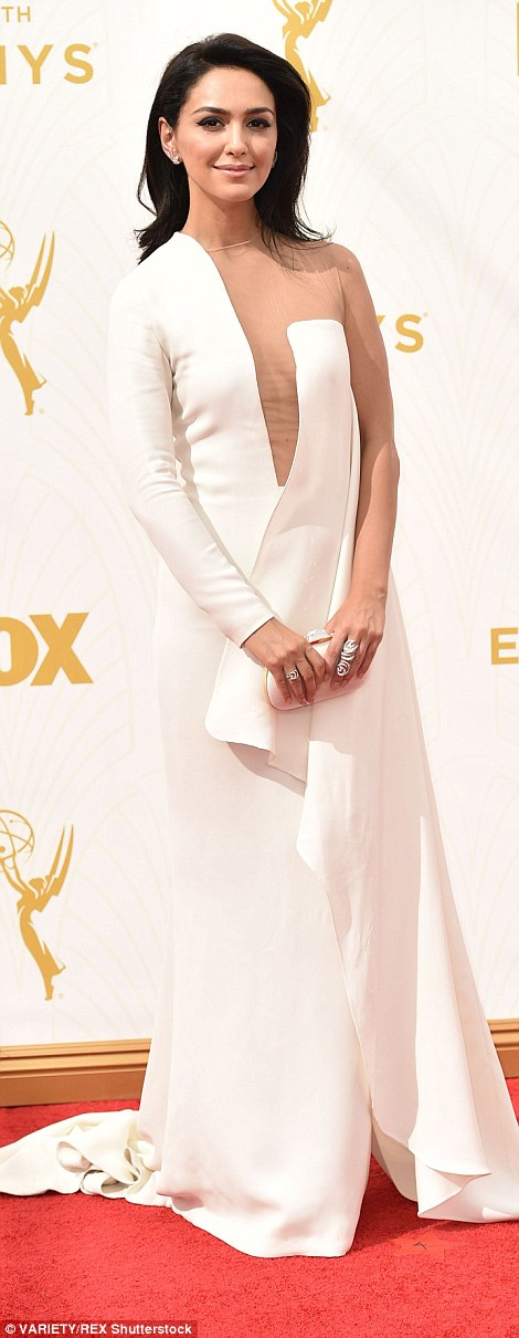 Nude but not: Although American Horror Story star Naomi Grossman (L) irked with the awkward placement of nude paneling on her gown, at least the garment fit, which cannot be said for Nazanin Boniadi's