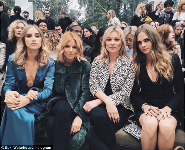 Selfie queens: Clearly enjoying herself at the show, Suki made sure to get a couple of selfies alongside her highly fashionable friends