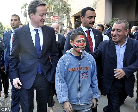 David Cameron meets Mohammed, 15, on a walk through the streets of Cairo