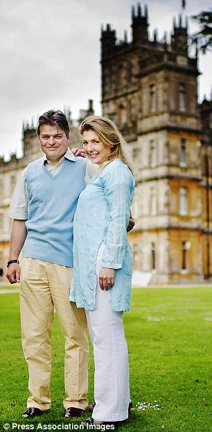 Happy days:Lord and Lady Carnarvon, pictured, in front of their home Highclere Castle, have turned Downton into a commercial success