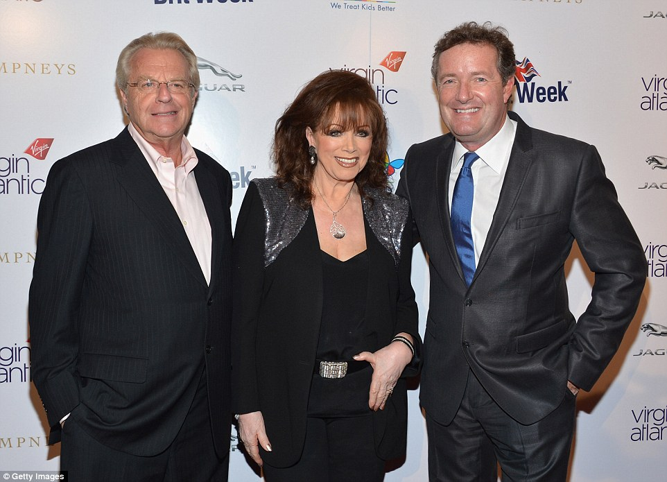 Jackie Collins poses for a photograph with TV show host Jerry Springer (left) and MailOnline Editor at Large Piers Morgan