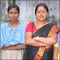 Aklina, former prostitute (left) with one of her rescuers