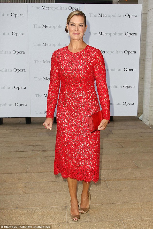 Stunning: Brooke Shields was sure to turn heads as she brought her red-carpet A-game in a cardinal red lace overlay gown, which showed off her enviable figure