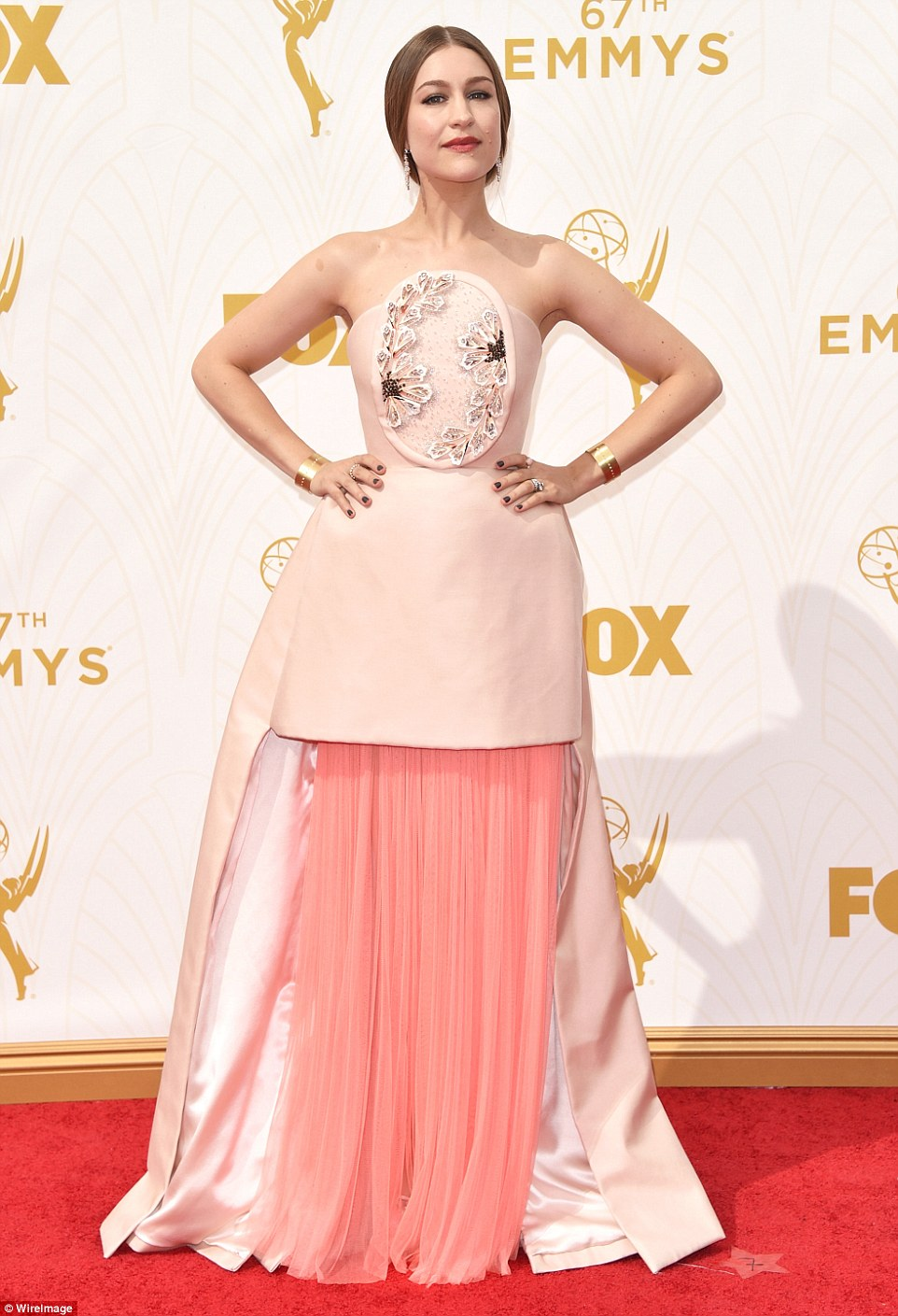 Making a statement: Singer Joanna Newsom - the wife of Emmys host Andy Samberg - looked like the dinner table met the drapes in this eccentric outfit