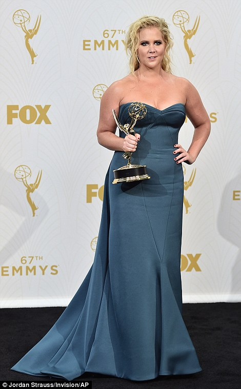 Amy Schumer may have taken home an award for her outstanding variety sketch series for Inside Amy Schumer, but her blue gown with badly placed panels and grungy beauty look wouldn't be helping her take home any trophies