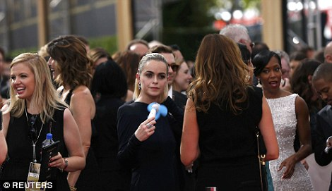Actress Taryn Manning waits to walk the red carpet as she arrives at the 67th Primetime Emmy Awards in Los Angeles, California