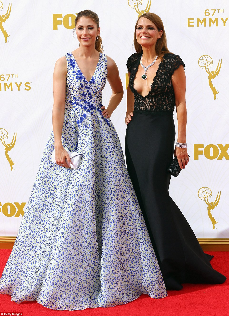 Taking the plunge! Amanda Crew wore a summery and colourful gown while Suzanne Cryer wore a very low-cut black dress
