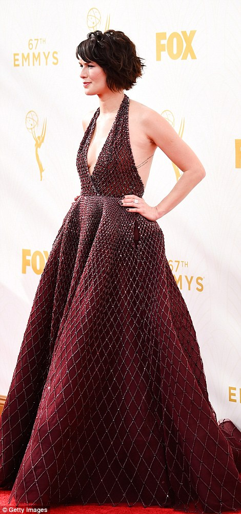 Backless: Game Of Thrones beauty LenaHeadey shimmered in a beaded maroon ballgown
