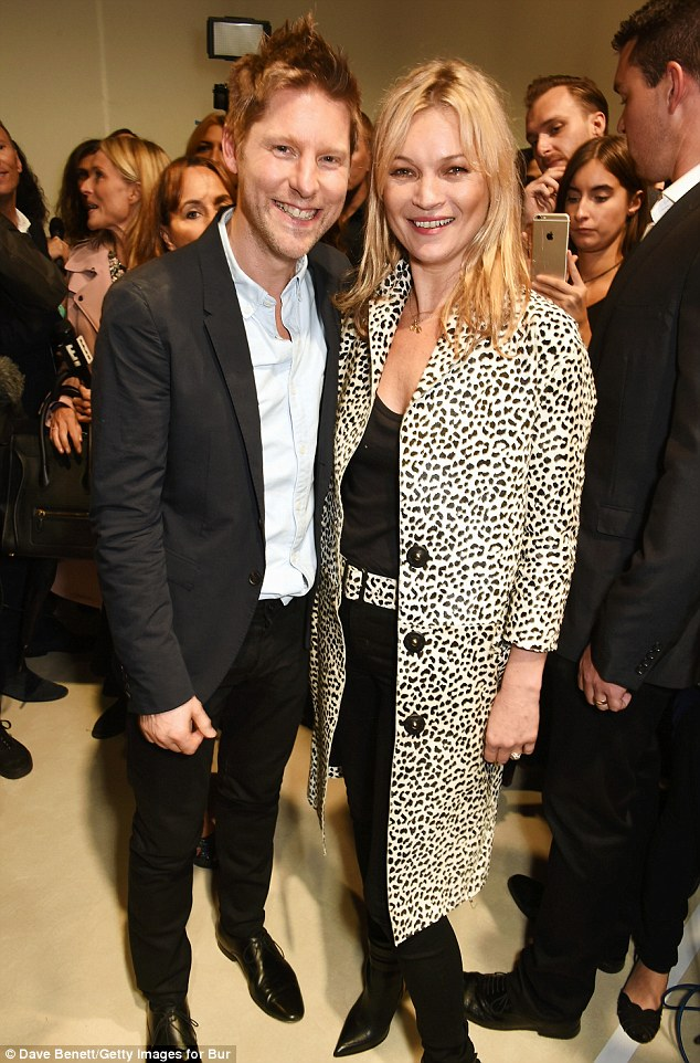Christopher Bailey, Burberry Chief Creative and Chief Executive Officer, and Kate Moss pose backstage at the Burberry Womenswear Spring/Summer 2016