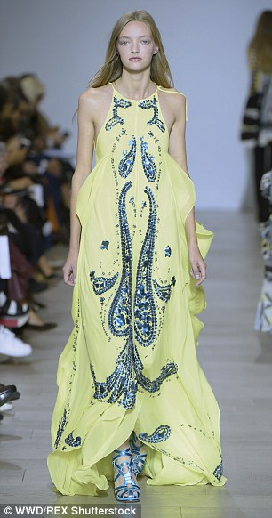 Showstopper: The models donned the catwalk in an array of soft lilac and yellow tones, while showing off both intricate and bold prints as they stormed the runway