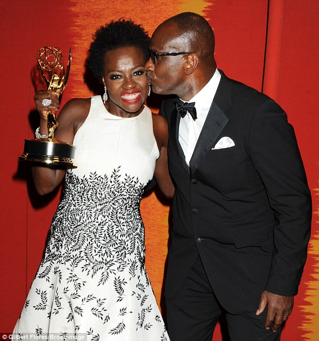 Kisses: Viola Davis receives a kiss on the cheek from her husband, Julius Tennon, at the HBO Emmy Party