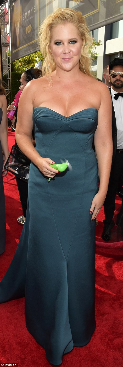 Jewel tones: Amy Schumer glowed in a shapely green gown while Christine Baranski popped in pink