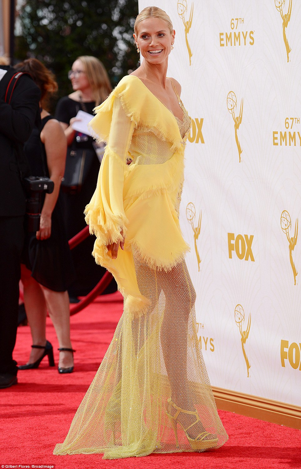 Statuesque: The blonde beauty teamed the garment with gold platform heels
