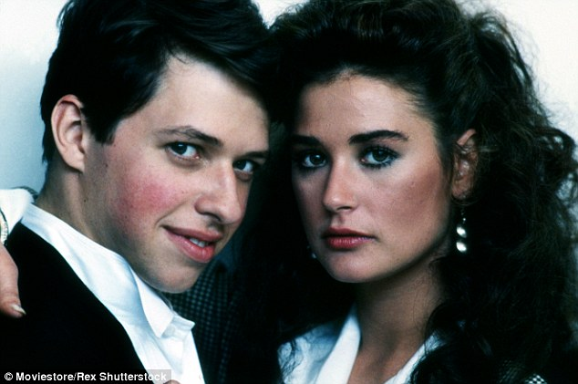 Awkward: Cryer, who found fame with Pretty In Pink in 1984, revealed in his recently published memoir he had dated Kutcher's future wife Demi Moore after they starred together in No Small Affair in 1984