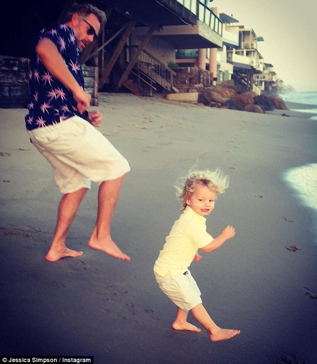 'Gettin' Jiggy Wit It': In another image, her two main men, husband Eric Johnson and son Ace, were making the most of California's hot weather by having a dance-off on the shore of a Malibu beach