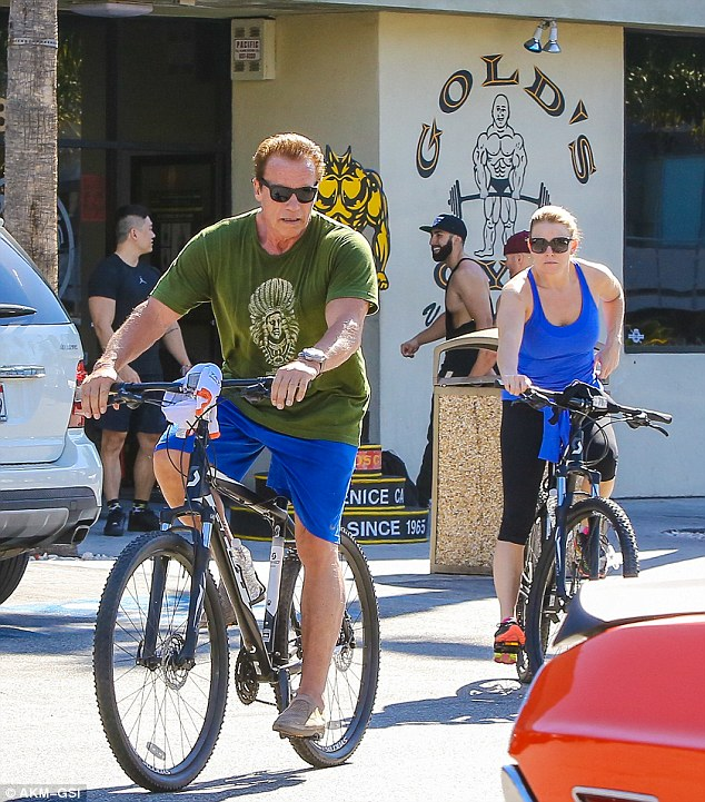 Cheaper wheels: On Sunday Arnie was seen leaving Gold's Gym in Venice after a workout with girlfriend Heather Milligan