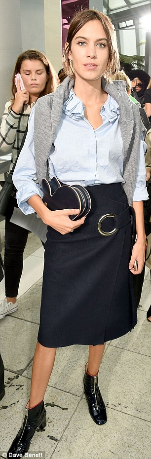 Effortless: TV presenter Alexa Chung 31 made ever the stylish appearance in a chambray blue shirt, tucked into a navy pencil skirt and worn with black patent zip-up ankle boots